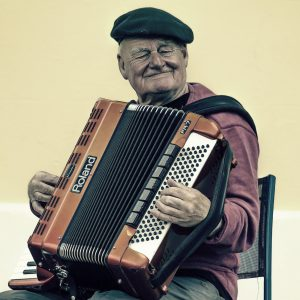 sitting accordian player wearing a beret