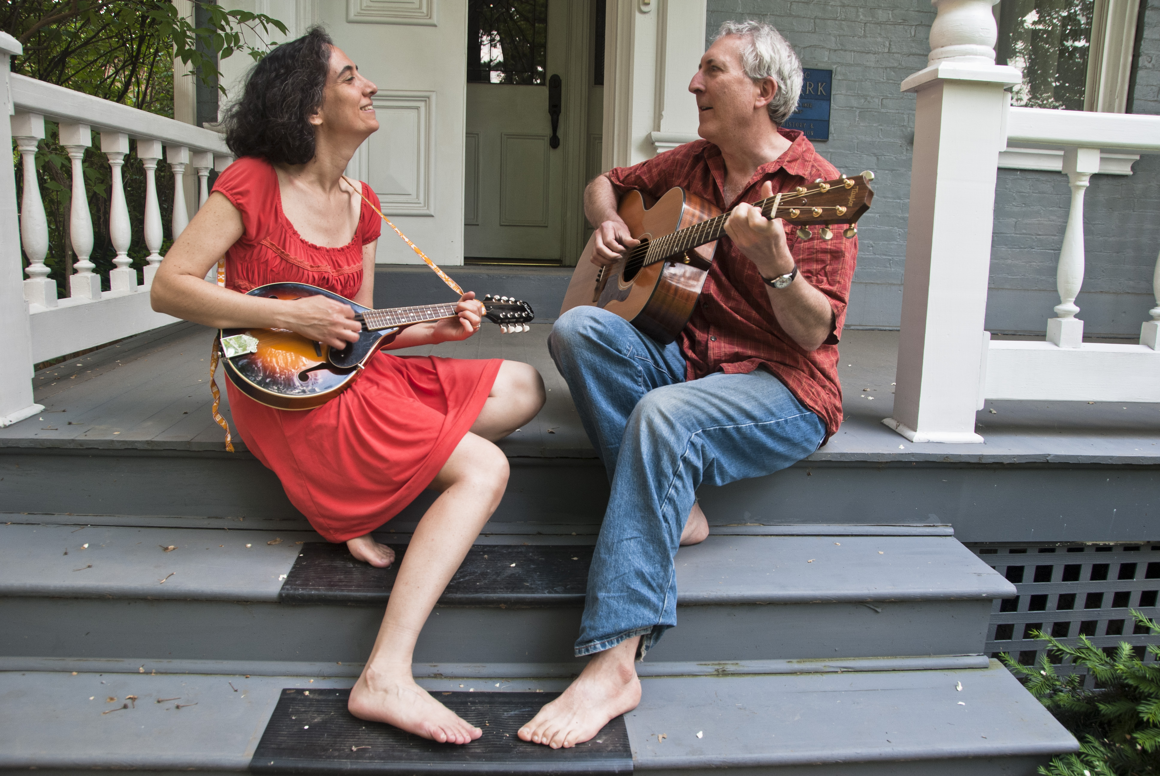 musicians sitting on the porch steps